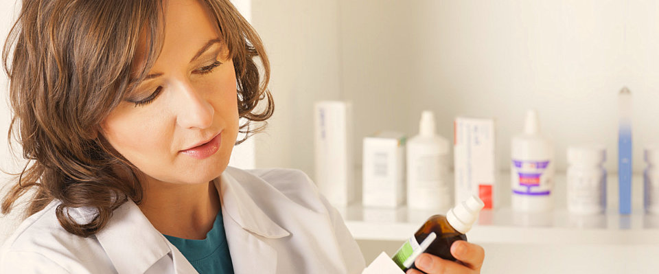 a pharmacist reviewing the medication on the bottle